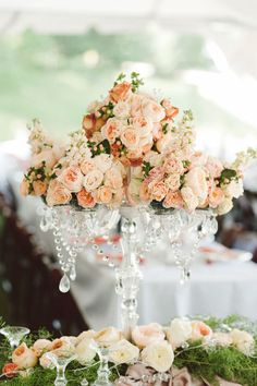 Lovely idea for a centerpiece: use a crystal candelabra and romantic roses