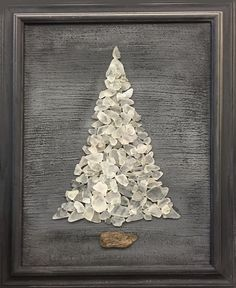 White beach sea glass tree on charcoal gray background, set in vintage charcoal frame. Tree base is driftwood. With it's cool gray and fresh white colors, this tree was made to be left out all year lo