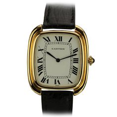 Cartier Yellow Gold Tank Gondole Wristwatch circa 1970s | From a unique collection of vintage wrist watches at https://www.1stdibs.com/jewelry/watches/wrist-watches/