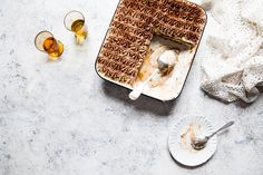 This a boozier version of tiramisù as I like to soak my homemade savoiardi (Italian sponge biscuits known as ladyfingers) in both marsala, which is traditional, and amaretto - an almond liqueur. I also add lemon zest to the biscuits.