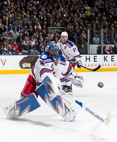 TORONTO, ON - FEBRUARY 23: Henrik Lundqvist #30 of the New York Rangers knocks the puck away from the net as teammate Ryan McDonagh #27 skates in during the third period of play against the Toronto Maple Leafs at the Air Canada Centre on February 23, 2017 in Toronto, Ontario, Canada. (Photo by Mark Blinch/NHLI via Getty Images)