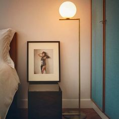 The IC F Floor Lamp from FLOS is a case study in balance. After watching a video clip of a contact juggler, designer Michael Anastassiades was inspired by the skill it took to spin and move the set of spheres around the juggler's body.