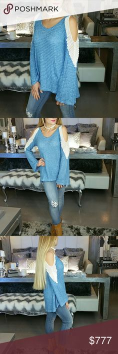 "Just arrived!! Cold shoulder knitted top Brand new no tags Boutique Item  Sassy blue cold-shoulder top with ivory details on sleeves. Pair with jeans and your favorite boots for a complete look. This top does not disappoint! It is sassy and feminine.   ●High low style● long sleeved●Tunic style  Material 64% polyester 34% rayon 2% spandex Small Bust16.5"" across /Length in front 24"", in back28"" Medium Bust 17.5/length 24""front-28""back Large Bust 19"" across/ length 24""front-28""back Tops Tunics"