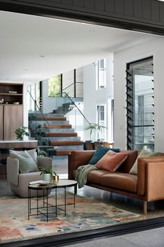 A spacious and sumptuous new build south of Sydney with soaring ceilings and steel frame windows and wooden staircase.