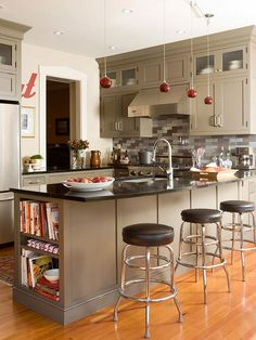Taupe Kitchen Cabinets and Red Pendant Lights