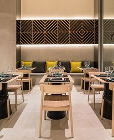The dining restaurant and privé area is part of a space with a subtle decoration woodwork and painting on the walls, combined with the special selection of furniture that blend natural wood oak tables and chairs with black color in different parts of other décor.