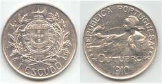 1 escudo em prata da Primeira República. É considerada uma das mais belas moedas portuguesas, datada de 1910,  para comemorar o dia 5 de Outubro de 1910, mas só foi cunhada em 1914.