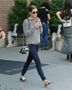 In step: She looked chic in a grey sweater and skinny jeans. The Girlfriend Experience also had on cow print slides and sunglasses