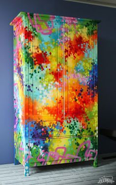 Beautiful spray painted furniture - looks like about 10 different colours used to achieve this effect