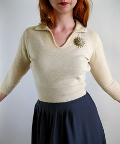 wear a vintage brooch with your sweater