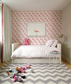 Day bed, flamingo wallpaper and large chevron area rug in this girls bedroom design | Bella Mancini Design