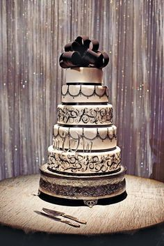 I love the detailing of this cake, I'd put on an actual bride and groom topper and use the wedding colors on the frosting