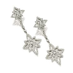 PAIR OF DIAMOND PENDENT EARRINGS, BUCCELLATI Of lacework design, decorated throughout with brilliant-cut diamonds altogether weighing approximately 1.00 carat, mounted in 18 karat white gold, signed Italy Buccellati.