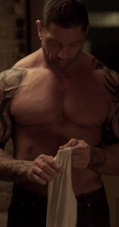 Dave Bautista photos, including production stills, premiere photos and other event photos, publicity photos, behind-the-scenes, and more.