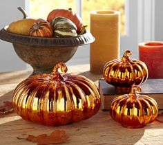 Orange Mercury Glass Pumpkins | Pottery Barn  These are too expensive, but I bet I can mimic them by buying cheap plastic pumpkins and finding some orange metallic spray paint.