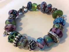 Trollbeads green lilac armadillo inspired this whole bracelet :)