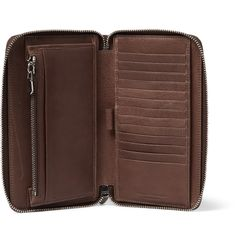 Brunello Cucinelli is renowned for its careful approach and sensitivity to traditional craftsmanship. This brown wallet has been constructed from durable textured-leather in the brand's headquarters - a 14th century castle in the Italian town of Solomeo. Just the thing for staying organised on business trips, it has multiple card slots, a zipped compartment and a neat pen holder.