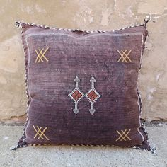 Handmade in: Mid Atlas Mountains in Morocco Width: 19'' Length: 19'' Material: Cactus Silk with embroidery. Detail: Pillows come stuffed with down insert. Each pillow is newly made and one-of-a-kind.