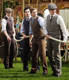 The guys showing off their best looks in a game of tug of war, final episode of Season 3