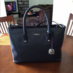 Furla blk purse w/crossbody strap. NWT Beautiful purse bought from Neiman Marcus. NWT Furla Bags Satchels