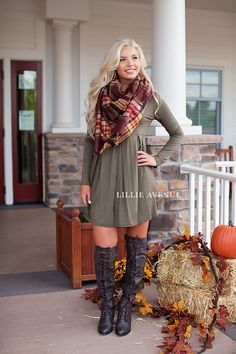 The perfect fall dress in olive! True to size. Complete this look with our rust blanket scarf and best in fashion fall boots in brown. Amazing thanksgiving outfit. Material: Rayon and Spandex. Made in