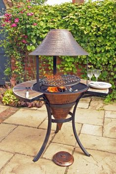 what a cute little grill this is!  Perfect for a small patio/garden area