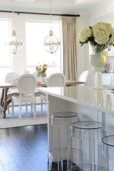 white marble countertops + bar seating