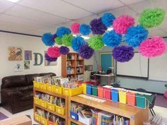 Make some easy Truffula flower pom-poms as ceiling decorations. | 36 Clever DIY Ways To Decorate Your Classroom