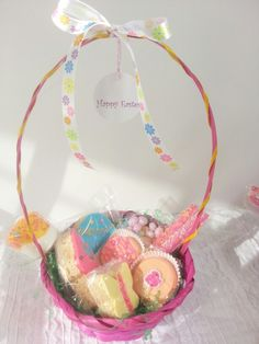 Girl Easter basket with rice krispies treats, chocolate covered Oreos, pretzels and marshmallows and jelly beans.