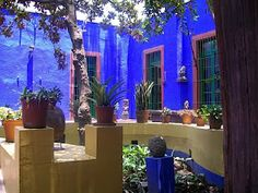 Frida Kahlo's house in Mexico City.  I would LOVE to have a courtyard like this- that blue makes me happy.