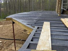 DekDrain. A rubberized system to divert runoff water from your deck so that the space below the deck is dry and useable.