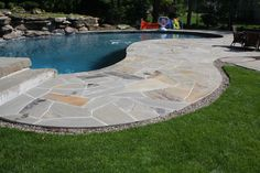 Stone Patio Construction in Rockland County, NY: This Irregular Tennessee Crab Orchard Patio is in Montebello, Rockland County , NY.  This is a greta stone for pool areas as it does not hold as much heat like many other stones.
