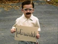 This kid is rocking Kip from Napoleon Dynamite for Halloween complete with the Lafawnduh sign.