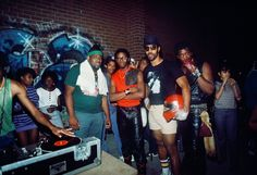 Bambaataa would organise parties at Bronx River Center, indoors or outdoors depending on the weather. Everyone would come, and eventually DJ, rap or dance. Kool Herc, with his helmet, is the godfather of hip hop and D.St was the best scratcher around