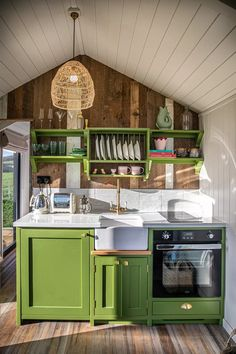 Small cottage kitchen ideas – design inspiration for rural homes | Country Small Cottage Kitchen, Cottage Kitchens, Green Kitchen, Room Kitchen, Outdoor Tub, Outdoor Baths, Plain English Kitchen, Hanging Pans, Wooden Beams Ceiling
