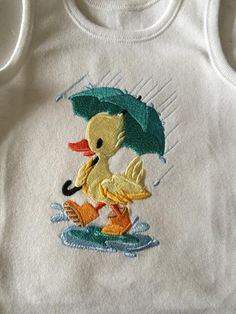 Rainy duckling, available on baby vests, t-shirts and baby blankets. Let us know if you want one:)