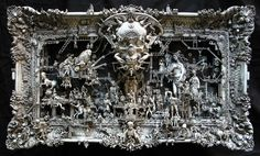 This is a Kris Kuksi sculpture. His work is beautiful in the same, rather disturbing way as Giger.