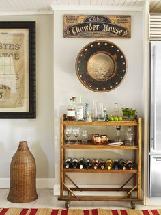 The key to incorporating a beachy vibe without feeling themed? Choose pieces with patina and sophisticated color schemes. The black-hued chowder house sign and porthole (lined with a photo of ocean waves) above the bar cart, for example, achieve a chic, not cheesy, look.