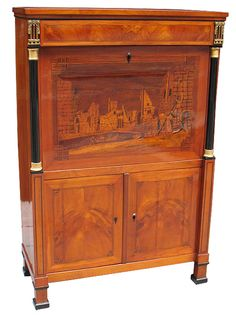 German Biedermeier secretaire (CLOSED) in cherrywood on oak. Fall-front, frieze drawer and bookmatch veneered doors panelled with hairlines. Greek Key motif. Ebonized columns with gold leaf trim. Magnificently detailed marquetry panel depicting houses, people and a lake with boats and swans. Fitted interior with eight drawers and niches. Before 1825. Southwest Germany (French border).