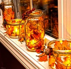 how to make fall mason jar lanterns. I'd just like to see these in a house. I do… how to make fall mason jar lanterns. I'd just like to see these in a house. I don't know if my house is the place for these. Oh hell, maybe it is. Fall Mason Jars, Mason Jar Lanterns, Mason Jar Crafts, Jar Candle, Fall Lanterns, Mason Jar Christmas, Paper Lanterns, Simple Christmas, Christmas Decor