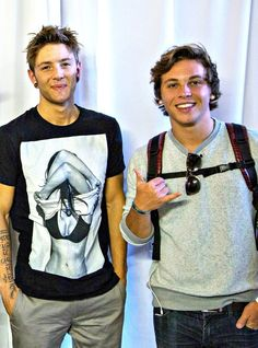 These are 2 guys from emblem3. There names are Drew Chadwick and Keaton Stromberg. The 3rd guy isn't in this picture but his name is Wesley Stromberg and he is Keaton's brother. Drew is a friend of Keaton and Wesley.