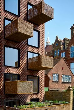Amin Taha Architects built this gabled apartment complex in the north of London, the UK. The building is six stories tall with six apartments.