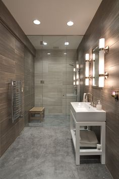 Stained/polished concrete flooring. Ceramic tile. Recessed lighting. Frameless zero clearance glass enclosure. Towel Warmer. Open vanity.