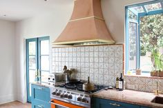 The Madrid range hood by Copperworks with brass accents. Made in USA since 1981. Call Copperworks today at 844-841-9343