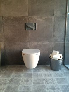 Our tiles: wall - Unika Smoke 600x600 http://www.europeanheritage.co.uk/products/tiles/concrete-effect/unika-smoke-rtt-600x600mm/, floor - Betonepogue White/Grey mix pattern 200x200 http://www.europeanheritage.co.uk/products/tiles/decor/betonepoque-pattern-white-grey-200x200mm/