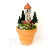 Potterville Fairytale Tower - Large Pot  -  Miniature Round Stone Tower - Terracotta Pot with Row Boat, Cattails, Flowers and Forest Trees. Etsy.