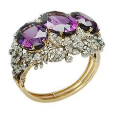 A magnificent antique amethyst and diamond bangle, England, circa 1880s.