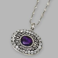 GOLD, SILVER, AMETHYST AND DIAMOND PENDANT-BROOCH, CIRCA 1900, WITH PLATINUM AND DIAMOND CHAIN. Oval amethyst weighing approximately 3.65 carats, framed by old mine and rose-cut diamonds weighing approximately 2.70 carats, with detachable brooch fitting, the chain set with round diamonds weighing approximately 3.20 carats, length 20 inches, with two detachable extendors each measuring 2 inches.