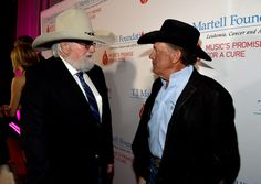 George Strait Photos Photos - Charlie Daniels and George Strait attend the T.J. Martell Foundation 9th Annual Nashville Honors Gala at Omni Hotel on February 27, 2017 in Nashville, Tennessee.at Omni Hotel on February 27, 2017 in Nashville, Tennessee. - 2017 Nashville Honors Gala - Red Carpet