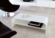 Contemporary glass coffee table with a shelf in choice of colours